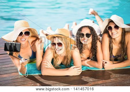 Happy friends enjoying their day together at the swimming pool
