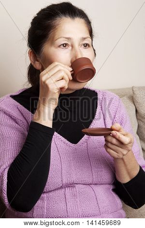 Attractive  senior woman drinking tea at home