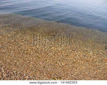 Stones at the bottom of the lake. Beautiful natural texture.