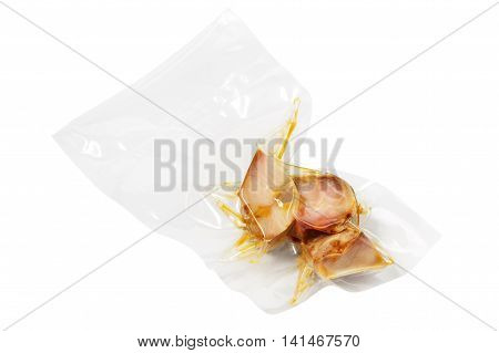 vacuum packed pieces of sturgeon on the white background with clipping path