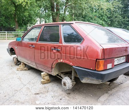 RUSSIA, YEKATERINBURG - JULY 21, 2016: Old Russian VAZ without wheels, unknown people took off and stole the wheel at night