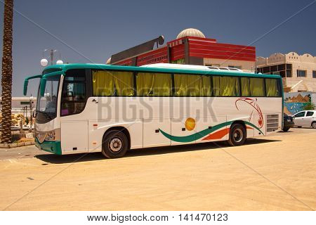 EGYPT, SHARM EL SHEIKH - JULY 20, 2015: Sharm el-Sheikh is holiday resort and significant centre for tourism in Egypt. Big tourist buses on parking.