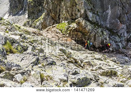 Tourists Entering The Mountain Pass.
