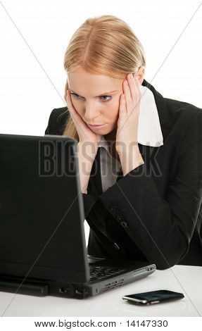 Stressful business woman working on laptop
