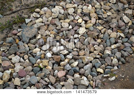 Different colored stones (round or not). A trail of rubble.