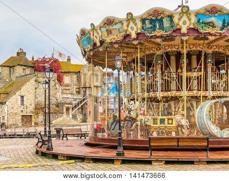 Old vintage carousel in Honfleur, Normandy, France