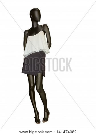 Female mannequin dressed in skirt and sleeveless top isolated on white background. No brand names or copyright objects.