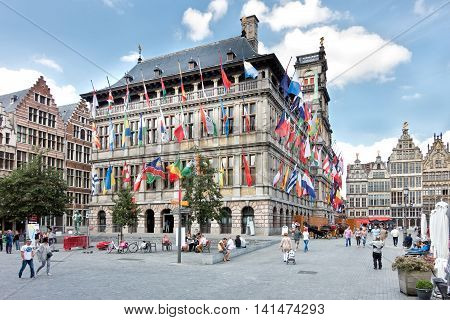 Antwerp Belgium - August 5 2016: Facade full of flags of the historic city hall at the great market (Grote Markt) in Antwerp