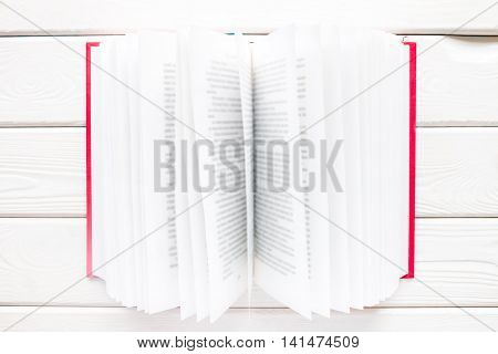 Open Book In A Red Hardcover With Blurred Text On A White Background