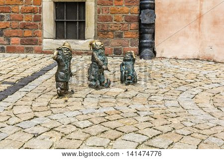 Three Figurines Of Dwarfs.
