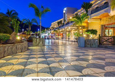 TAURITO, GRAN CANARIA, SPAIN - APRIL 22, 2016: Beach and resort complex in Taurito at night, Gran Canaria island, Spain. Taurito is very popular tourist destination on Gran Canaria.