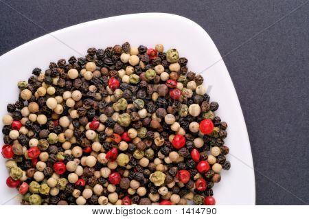 Red, Green, White Pepper, Pimento And Schinus In A Dish Closeup