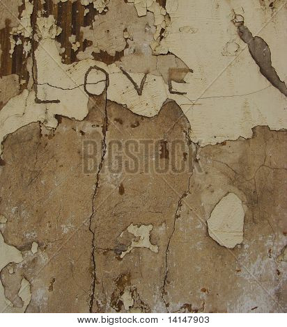 The Word Love Scratched Engraved In An Old Wall