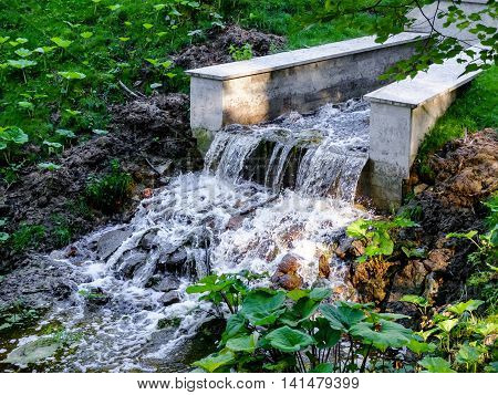 Small antique waterfall in Pavlovsk Park Saint-Petersburg. Great place for recreation and tourism.