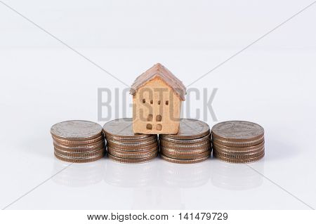 House and coins stack, saving and realestate concept