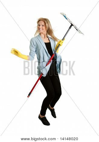 Excited woman having fun while cleaning