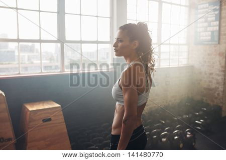 Healthy Crossfit Woman Relaxing In The Gym