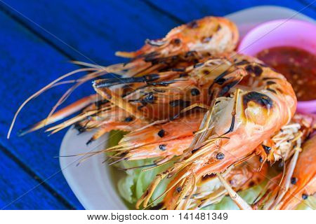 grilled shrimp with seafood sauce on a plate Thai local food.