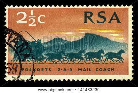 South Africa - CIRCA 1969: a stamp printed in the South Africa shows mail coach from 1869, 100 years stamps of the South African Republic, circa 1969