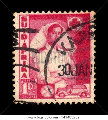 South Africa - CIRCA 1941: a stamp printed in the South Africa shows nurse and ambulance, series war effort, circa 1941