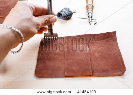 Work with a tool for leather and fabric