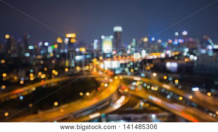 Blurred lights night view city and highway interchanged at night
