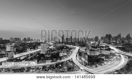 Black and White, Aerial view highway interchanged with city downtown background at twilight, long exprosure