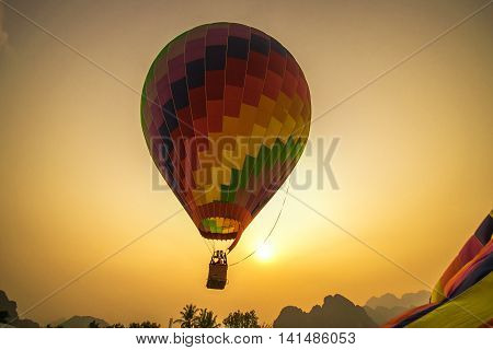 Floating Hot Air Balloon in Vang Vieng/ A coloful hot air balloon is being released in Vang Viang