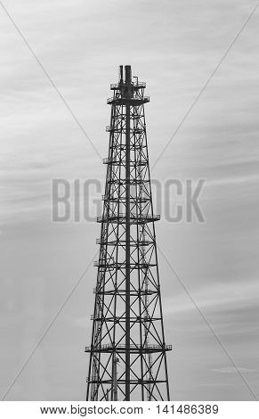 Black and White, Oil Refinery Tower with natural sky background