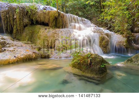 Deep forest blue stream waterfall in national park of Thailand