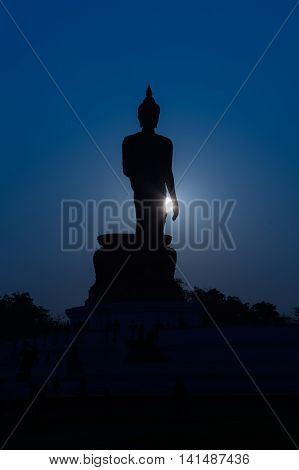 Silhouette Buddha night lights background, shadow photography Buddha images