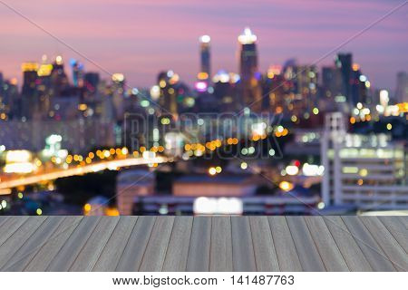 Opening wooden floor, Blurred city lights night view, multiple colours abstract background