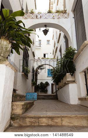 Traditional spanish arquitecture in a street of Roc of Sant Gaieta village in Roda de Bera Tarragona Catalonia Spain.