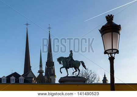 View of Luxembourg city - churches, monument, street lamp