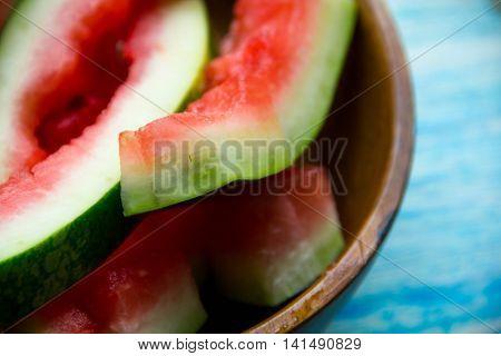 eaten slice of watermelon. Watermelon Rind. watermelon rind cut in piece on black plate