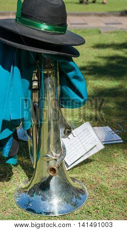 Brass musical instrument put on ground with hat when band takes a break on St Patrick's Day