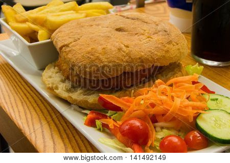 Huge burger with crispy chicken ready to get eaten!