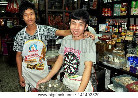 Bangkok Thailand - December 16 2010: Two friendly youths at a grocery store on Charoen Krung Road