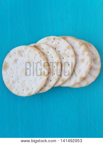 water crackers on a turquoise wooden background