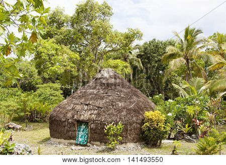 The straw hut surrounded by tropical greenery in Easo village (Lifou island New Caledonia).