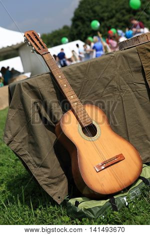 Guitar next to table in the summer park