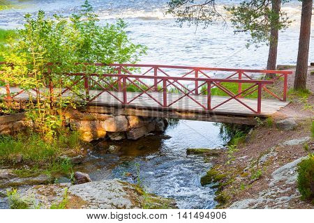 Small Wooden Bridge With Red Railings