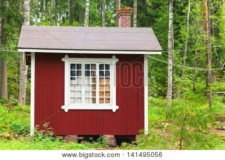 Small Scandinavian Red Wooden House In Forest
