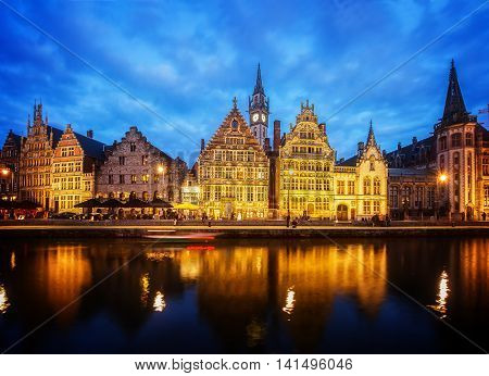 Embankment of old town at blue night, Ghent, Belgium, toned