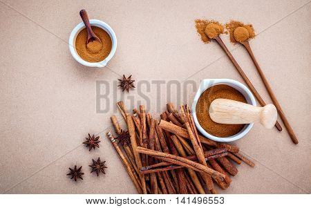 Composition Of Cinnamon Stick And Cinnamon Powder In White Mortar With Star Anise ,bay Leaves And Wo