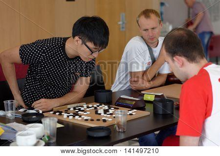 ST. PETERSBURG, RUSSIA - AUGUST 5, 2016: Mateusz Surma of Poland (right) vs Kim Yongsam of Korea in the main tournament of European Go Congress. Kim Yongsam won the tournament