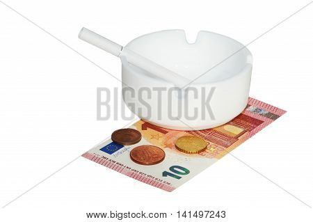 White ashtray with cigarette euros banknotes and coins on the white background