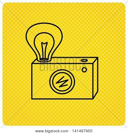 Retro photo camera icon. Photographer equipment sign. Camera with lamp flash. Linear icon on orange background. Vector