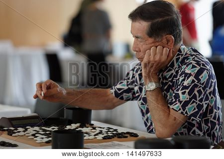 ST. PETERSBURG, RUSSIA - AUGUST 5, 2016: Unidentified participant of main tournament make a move during the European Go Congress. 1176 people from 48 countries are registered in this 60th Congress