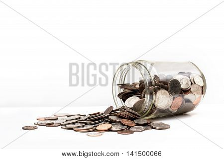 A glass pot fell and drop a bunch of coins